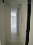 Passage to Bedrooms Before Renovation