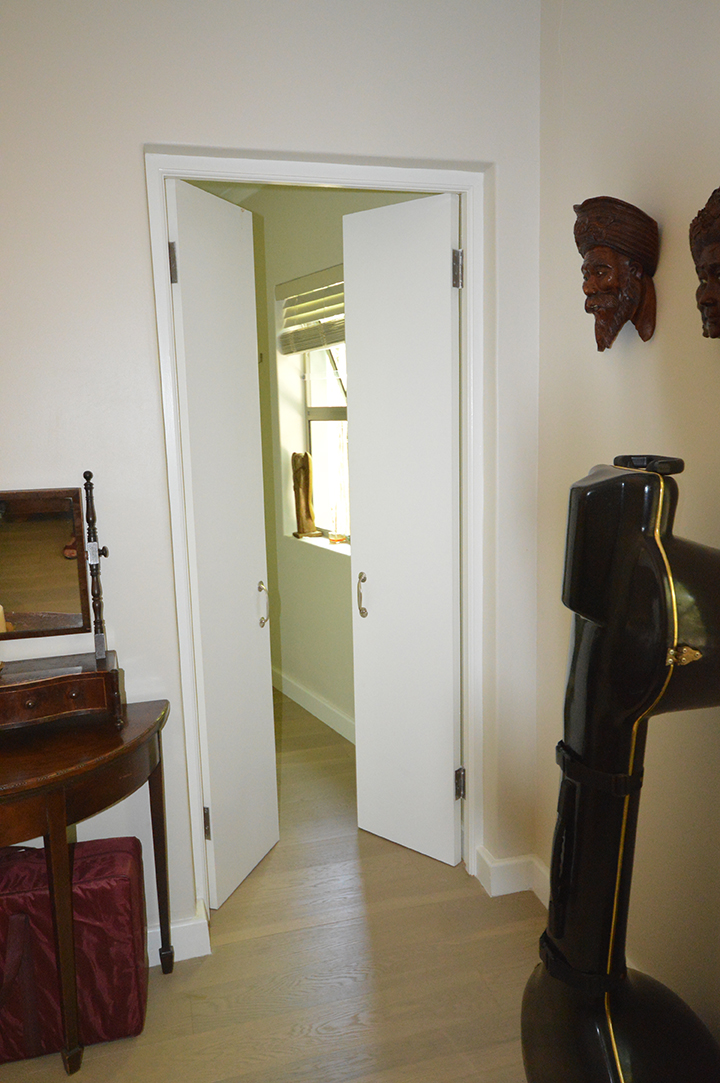 Double doors to small guest bathroom