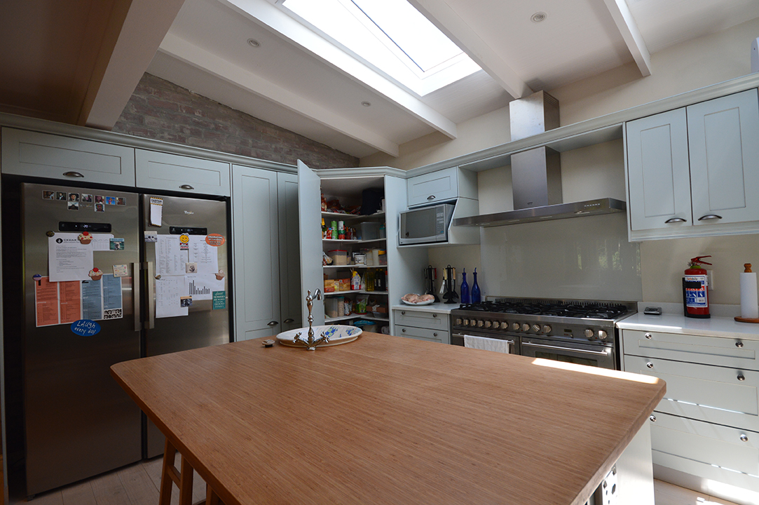 Kitchen with corner grocery cupboard